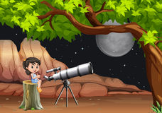 Girl looking at stars and moon through telescope Royalty Free Stock Images