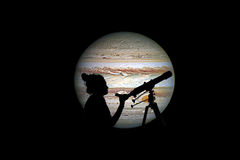 Girl looking at the stars with telescope. Jupiter planet. Isolated on black. Elements of this image are furnished by NASA royalty free stock photo