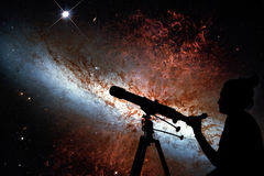 Girl looking at the stars with telescope. Messier 82. Cigar Galaxy or M82 in the constellation Ursa Major Elements of this image are furnished by NASA stock photo