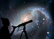 Girl looking at the stars with telescope. Stellar Nursery Royalty Free Stock Images