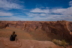 Girl looking at Stevens Arch from Crack in the Wall Escalante Royalty Free Stock Photo