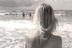 Girl looking in the stormy sea Stock Image