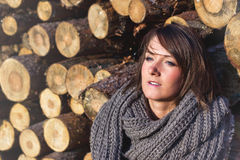 Girl looking at sunset. Girl looking at sunset with logs on the back Royalty Free Stock Photo