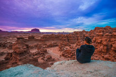 Girl looking at Sunset Sky over the Goblin Valley Royalty Free Stock Photos
