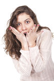 Girl looking surprised. Portrait of a surprised young woman with hands over her mouth Royalty Free Stock Images