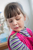 Girl looking suspiciously on papilio machaon Royalty Free Stock Photos