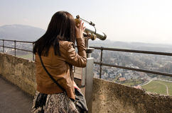 Girl looking through telescope Royalty Free Stock Images