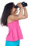 Girl looking throuth the binoculars Stock Photo