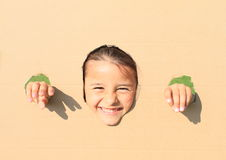 Girl looking thru hole Royalty Free Stock Images