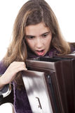 Girl looking to an empty briefcase Royalty Free Stock Images