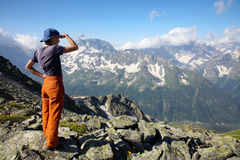 Girl looking to far mountains Royalty Free Stock Images