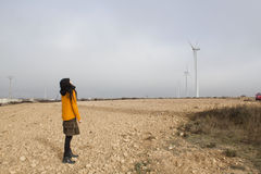 Girl looking to the land with mill winds. In Zaragoza, Spain Royalty Free Stock Photos