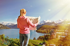 Girl looking to the map Stock Photos