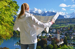 Girl looking to the map Stock Photography