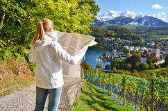 Girl looking to the map Royalty Free Stock Images