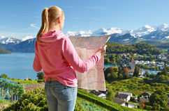 Girl looking to the map Royalty Free Stock Photography