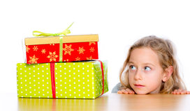 Girl is looking to presents Royalty Free Stock Photos