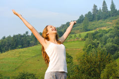 Girl looking to a sky in mountain. Royalty Free Stock Image