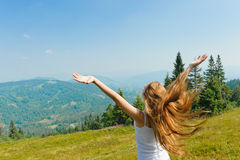 Girl looking to a sky in mountain. Stock Photos