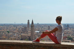 Girl looking to Verona town Stock Photo