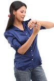 Girl looking in to the watch. With blue shirt Royalty Free Stock Photos