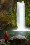 Girl looking at Toketee Falls Douglas County Oregon Royalty Free Stock Images