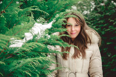Girl looking trough tree branch. Girl in forest looking trough tree branch Stock Image