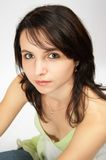 Girl looking up. Beautiful young girl with green eyes looking up royalty free stock photos