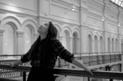 Girl looking up on the balcony. In black and white royalty free stock photography