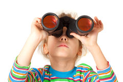 A girl looking up through binocular Stock Images