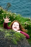 Girl looking up the Cliffs of Moher Tourist Attraction in Ireland Royalty Free Stock Image