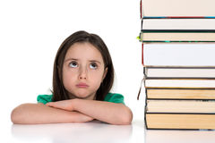 Girl looking up at the pile of books royalty free stock images
