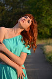 Girl looking up. Red-haired girl in blue is looking up Royalty Free Stock Images