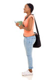 Girl looking up. Side view of african american college girl looking up Stock Images