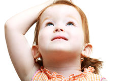 Girl looking up. Sweet Little girl looking up to the copy space area Royalty Free Stock Photos