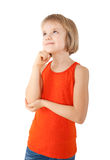 Girl looking up and thinking. Cute little girl thinking about something Royalty Free Stock Photos