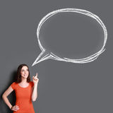 Girl looking up to bubble speech Stock Photos