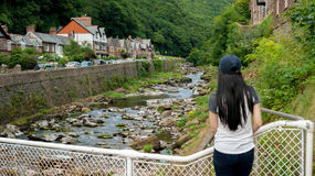Girl looking up the valley of the East Lyn River. In Lynmouth in North Devon England UK Royalty Free Stock Photography