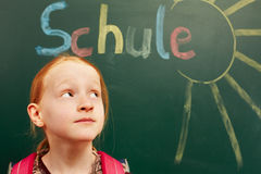 Girl looking up. Young girl looking up to the chalkboard stock photo