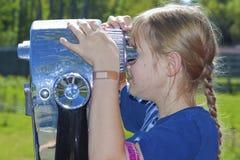 Girl looking through viewfinder stock image