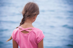 Girl looking at water surface Royalty Free Stock Images