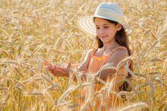 Girl looking of wheat's spica Stock Image