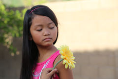 Girl Looking at Yellow Flower Royalty Free Stock Photo