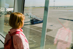Girl looks on an airfield Royalty Free Stock Photo