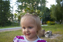 Girl looks aside with a leaf wreath Royalty Free Stock Photography