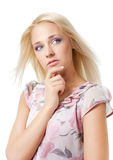 Girl looks away and thinks. Stock Photos