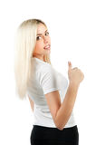 Girl looks back and shows thumb Royalty Free Stock Photo
