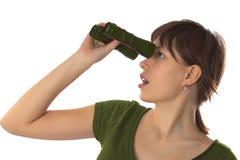Girl looks in the binoculars Royalty Free Stock Image