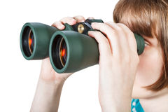 Girl looks through binoculars isolated on white Stock Photo