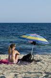Girl looks blue sea Stock Photo